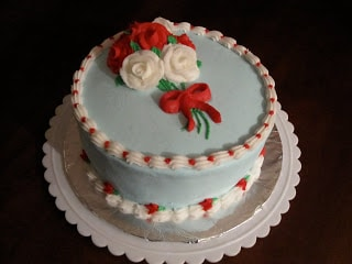 A birthday cake with piped roses