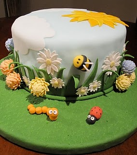 Fully decorated cake on a table.