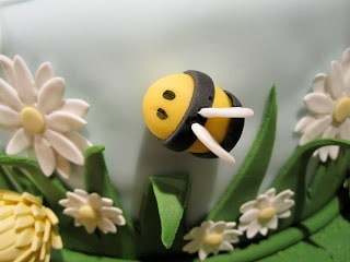 A close up of a fondant bee