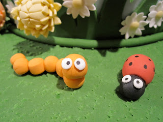 Close up of a fondant caterpillar and ladybug