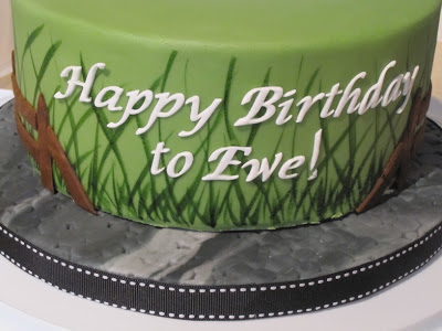 Fondant letters on the side of the cake.