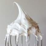 Marshmallow fluff on a whisk.