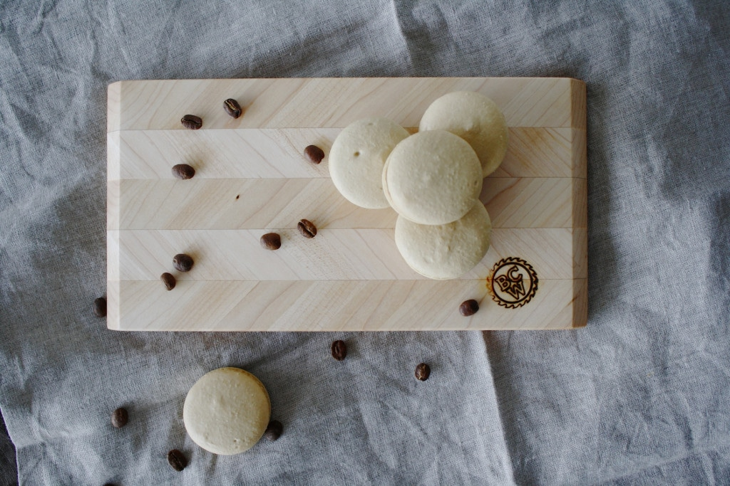 Macarons on a cutting board.