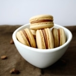 Macarons in a white bowl.