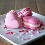 Heart macarons on a plate.