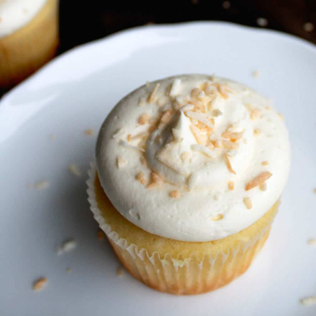 Coconut cupcakes topped with vanilla buttercream and toasted coconut. | livforcake.com