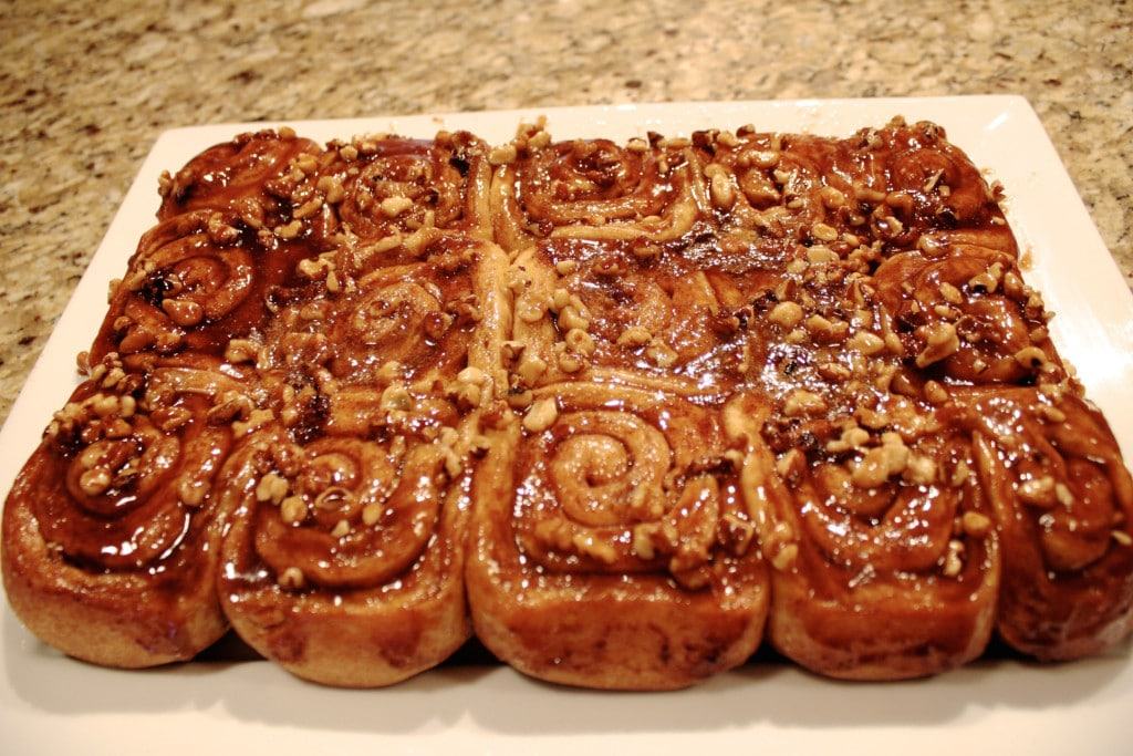 Cinnamon rolls flipped out onto serving dish