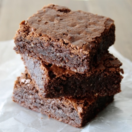 Close up of a Stack of brownies.