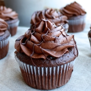 Chocolate cupcakes on a table.