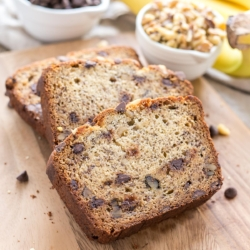 Banana bread slices on a cutting board.