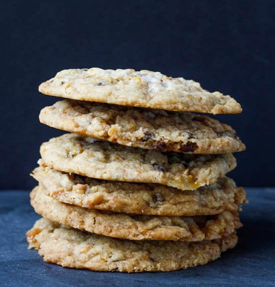A stack of cookies on a dark background.