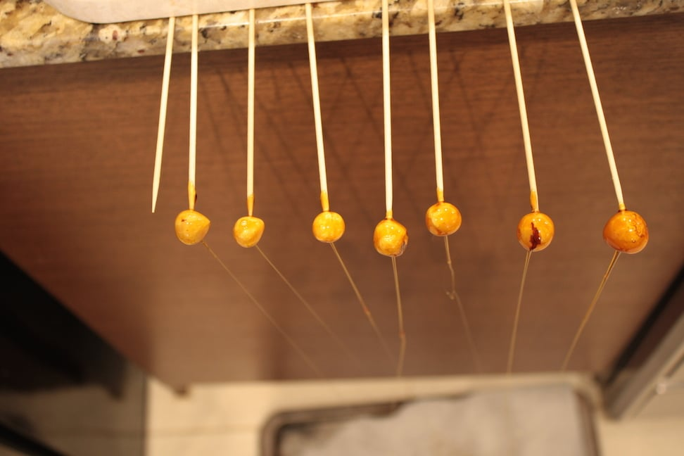 Candied hazelnuts on skewers.