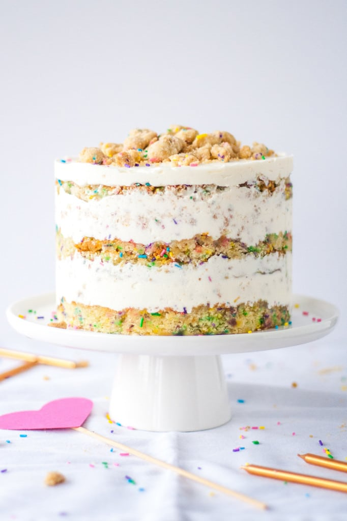 The Ultimate Birthday Cake. A sweet funfetti cake, topped with a cream cheese buttercream, and delicious cookie crumble. | livforcake.com