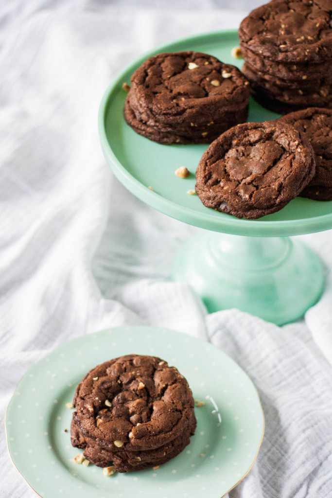 Cookies on a mint green plate.