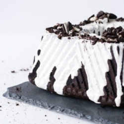 Square bundt cake on a slate plate on a white background.