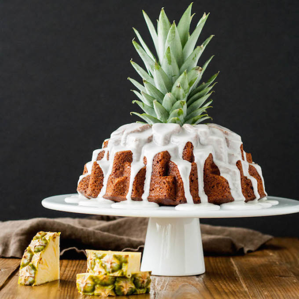 Tropical bundt cake with a pineapple stalk sticking out of the middle.