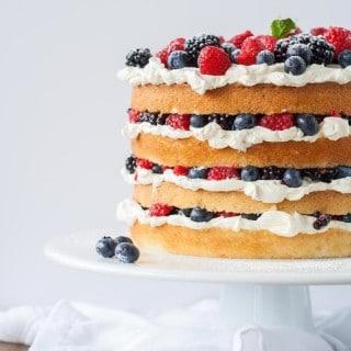 Layers of vanilla cake, swiss meringue buttercream, and loads of fresh berries. | livforcake.com