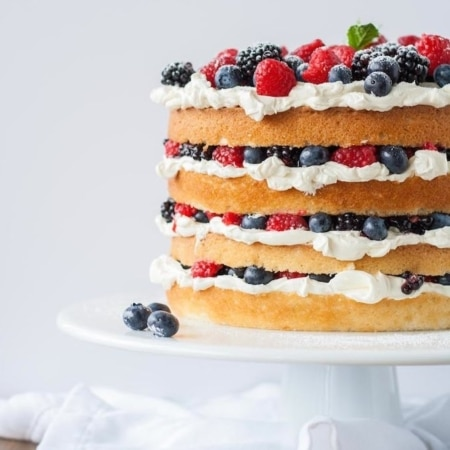 Cake on a white cake stand.