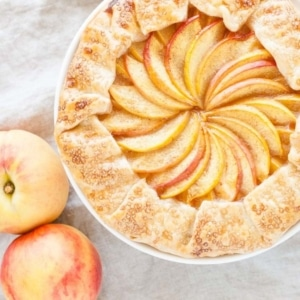 Overhead shot of the galette with peaches next to it.
