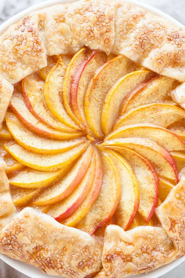 Close up of the pattern of slices peaches in the middle of the galette.
