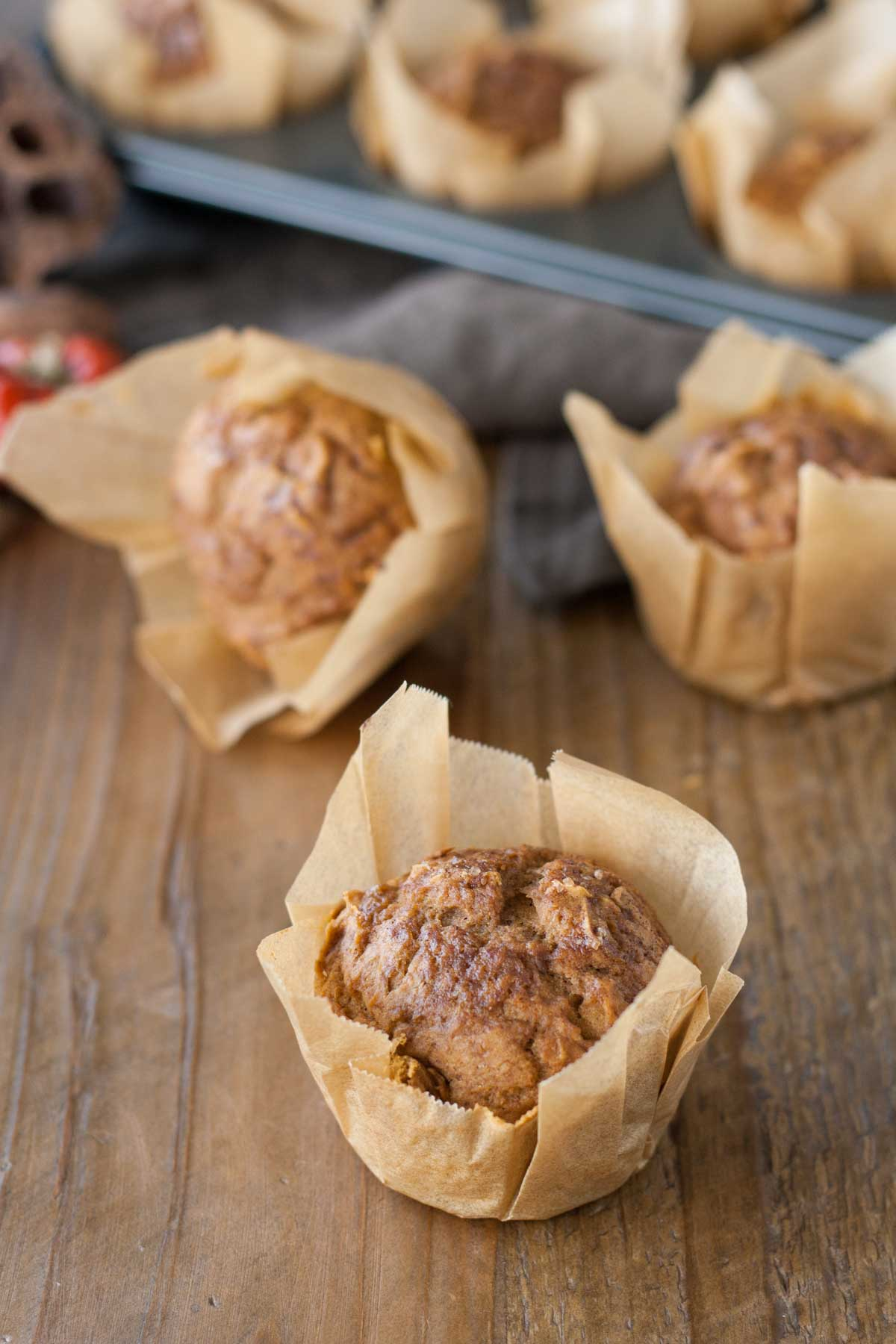 Muffins on a wooden table.