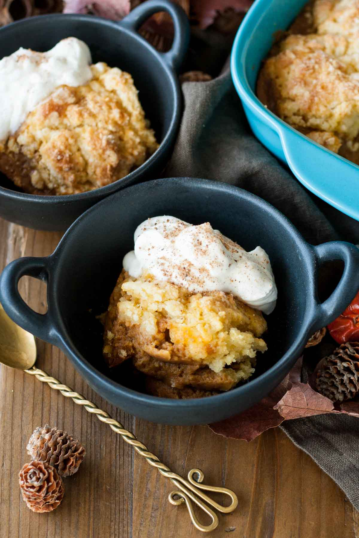 Pumpkin cobbler is the perfect comfort food for chilly Fall evenings and a wonderful way to wrap up your Thanksgiving dinner.   livforcake.com