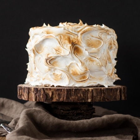 Cake on a rustic wood cake stand.