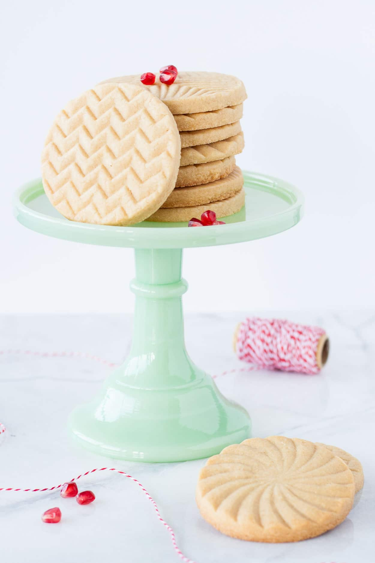 Cookies on a green cake stand.