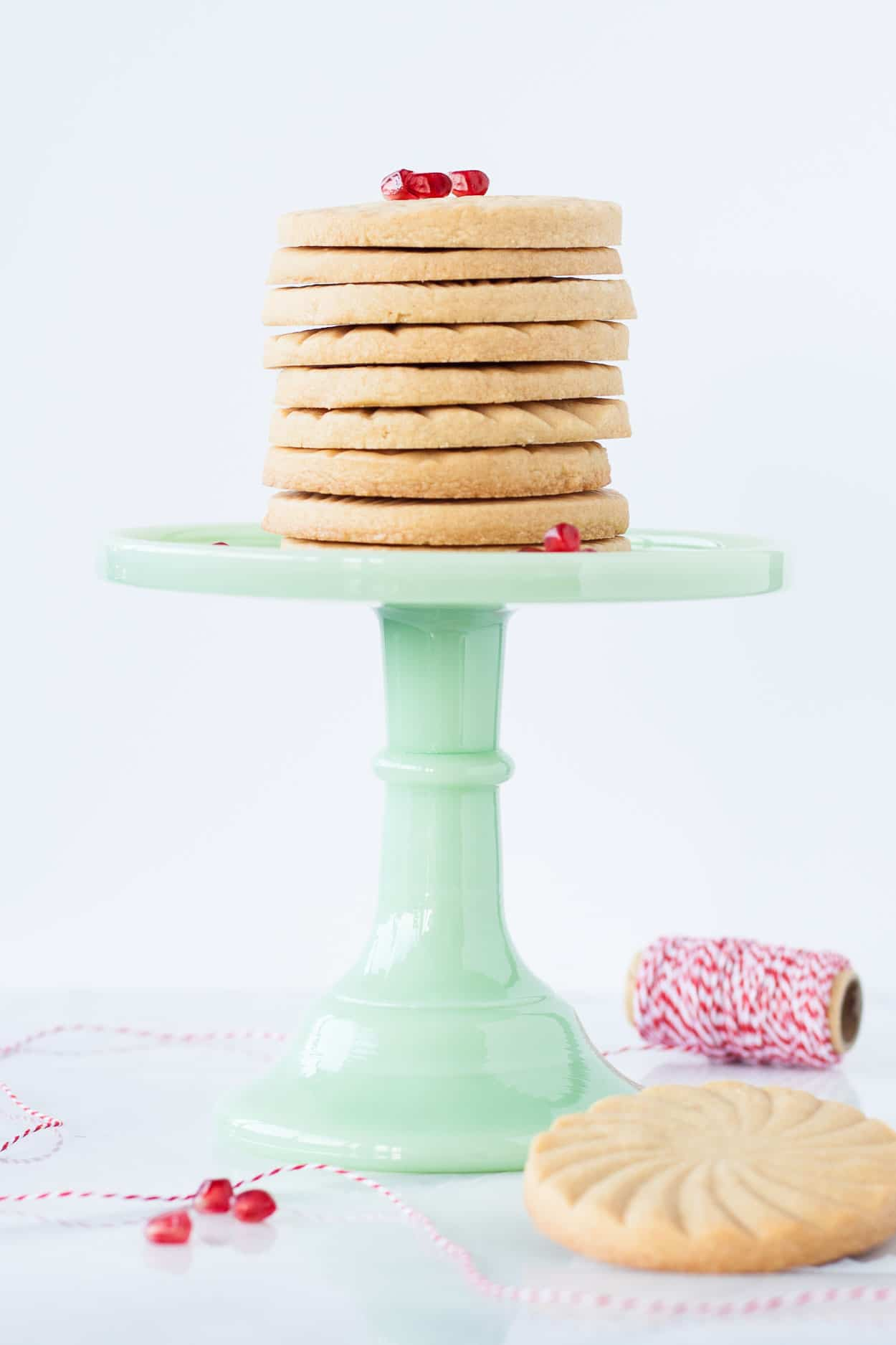 Cookies stacked on a green cake stand.