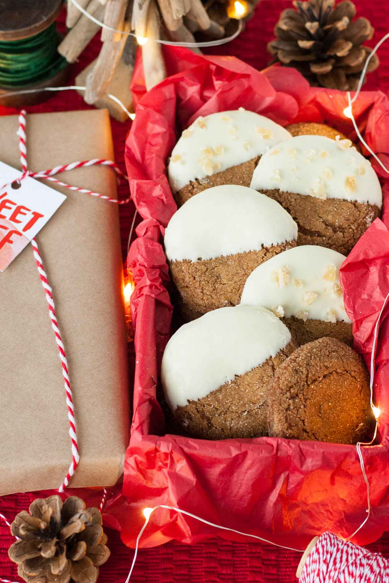 A box of white chocolate dipped chewy gingerbread cookies