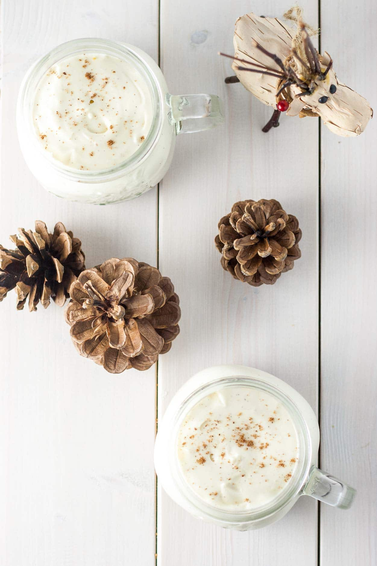 Overhead shot of eggnog mousse in jars.
