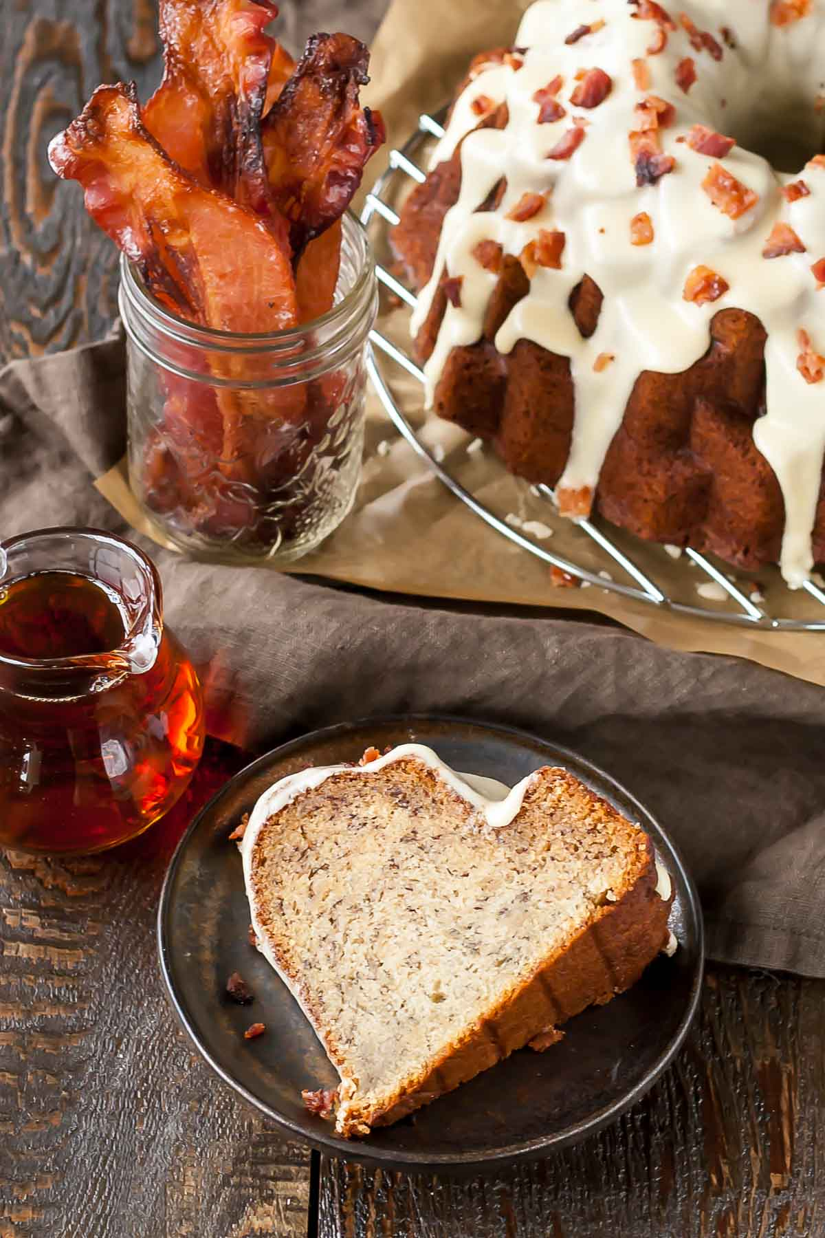 Banana Bacon Bundt Cake. Your favourite breakfast flavours in one delicious cake! Banana cake with a maple sugar glaze topped with chopped candied bacon. | livforcake.com