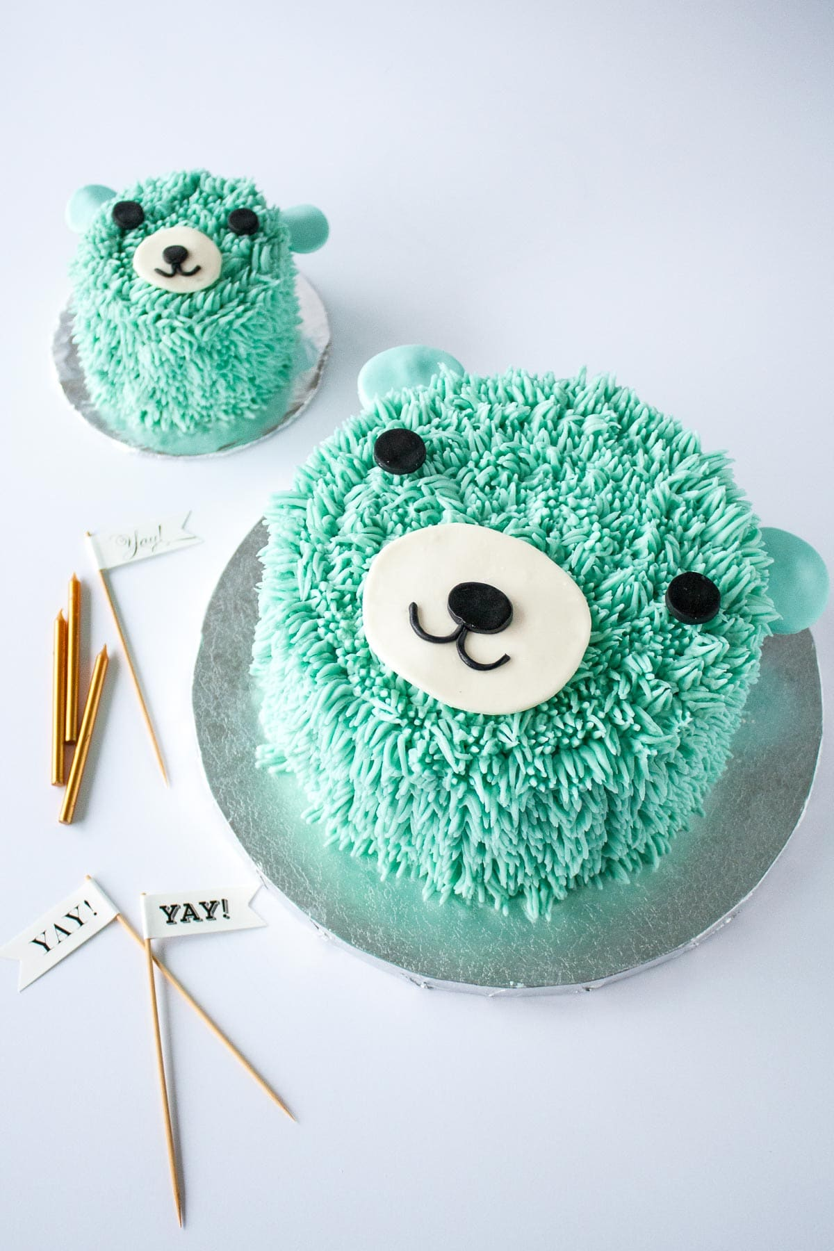 Two blue bear cakes on a white background.