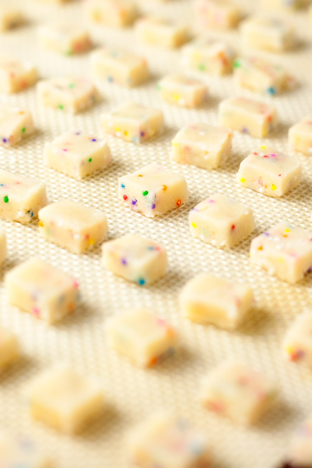 Shortbread bites before baking on a baking sheet.