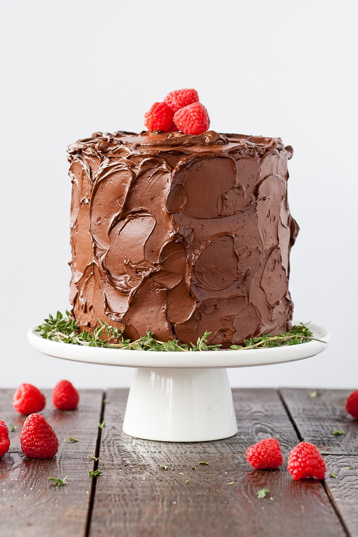 This Chocolate Raspberry Cake has six glorious layers of vanilla cake with raspberry sauce and a rich dark chocolate frosting. | livforcake.com