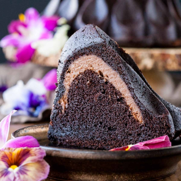 Double the chocolate in this delicious Chocolate Cheesecake Stuffed Bundt Cake! A rich chocolate cake filled with a decadent chocolate cheesecake. | livforcake.com
