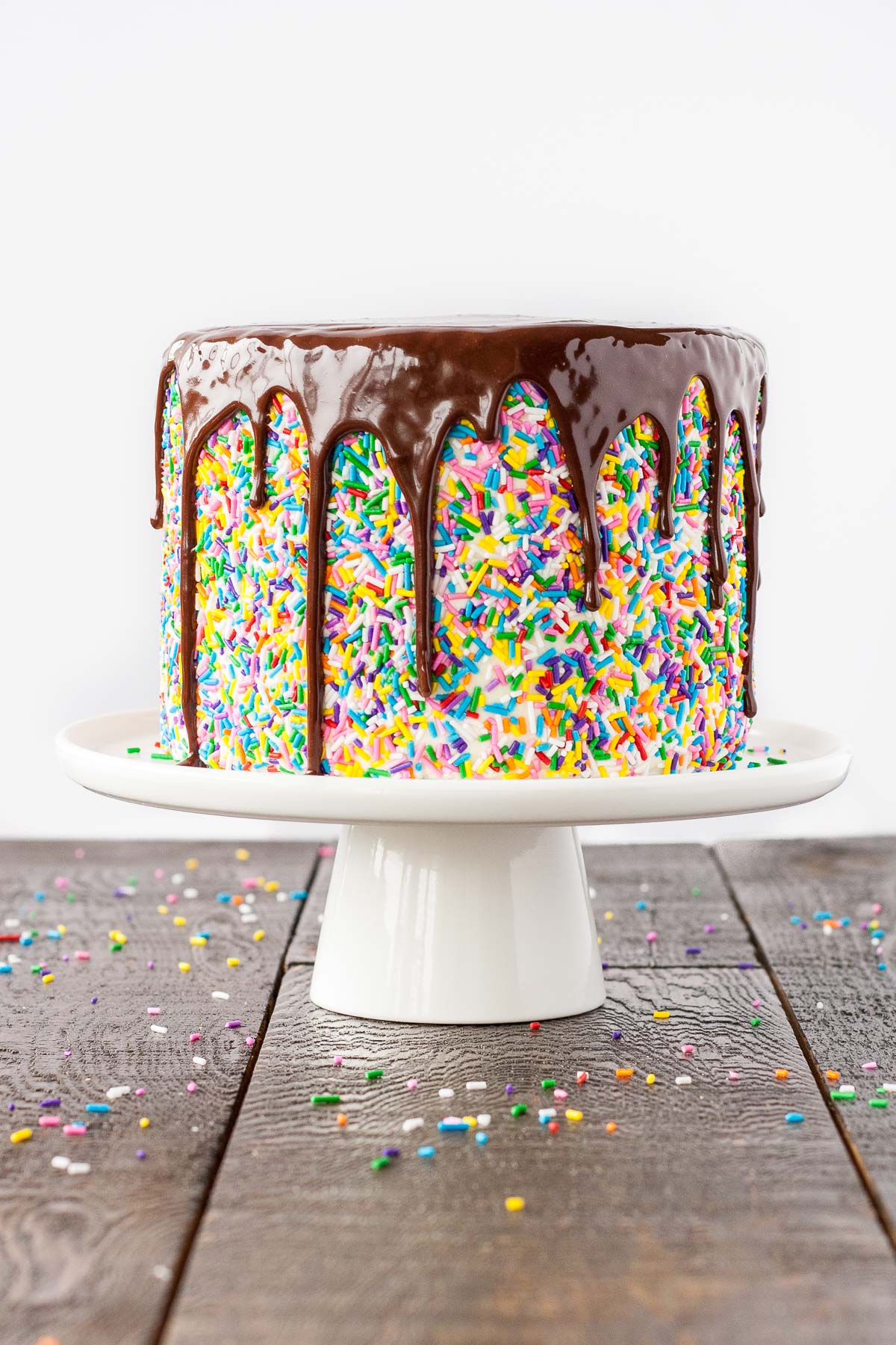 This Sprinkle Studded Funfetti Cake Is Paired With A Fluffy Cream Cheese Frosting And Topped With A Rich Dark Chocolate Ganache