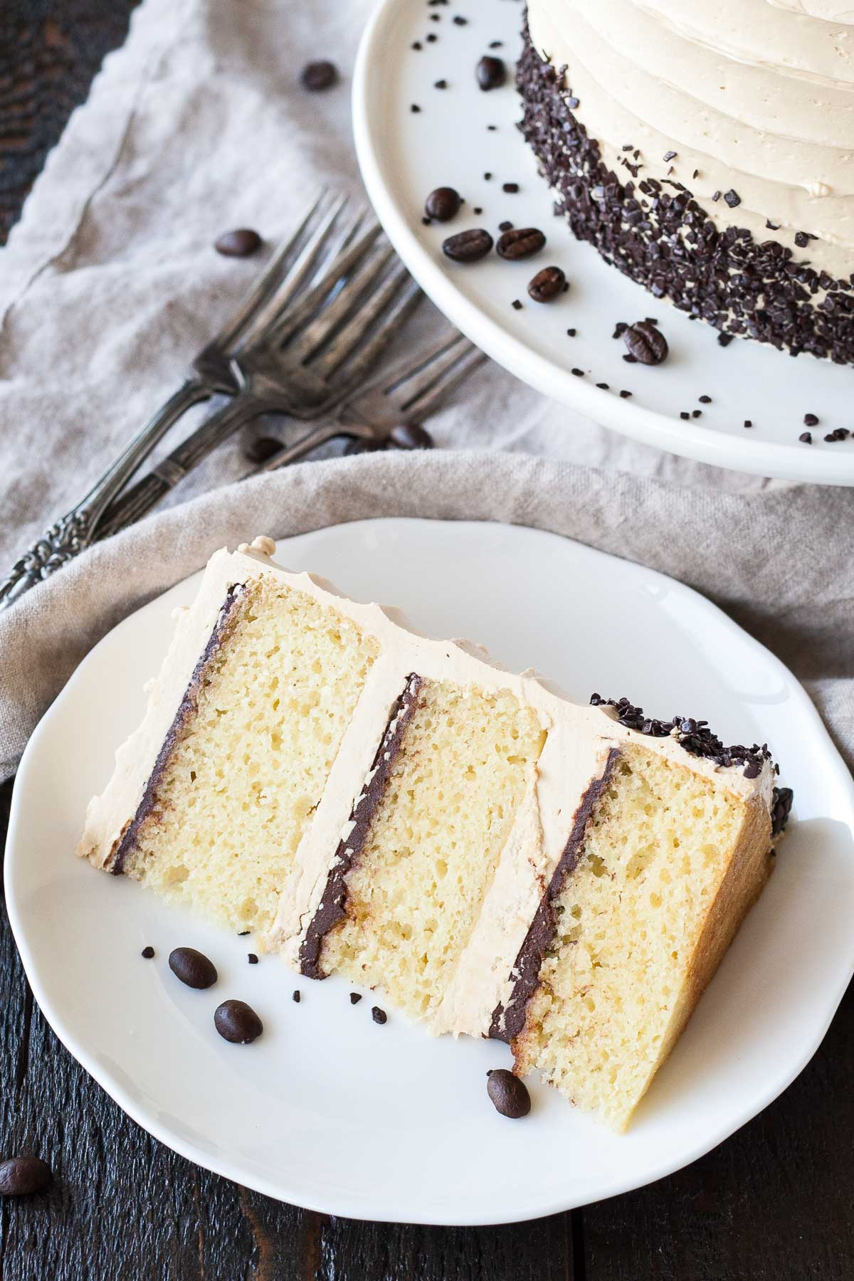 The perfect pairing of coffee & Baileys in this delicious layer cake. A vanilla cake layered with dark chocolate ganache and a coffee Baileys buttercream. | livforcake.com