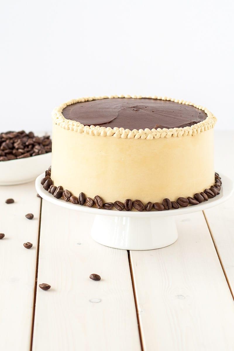 Decadent opera cake with espresso beans.