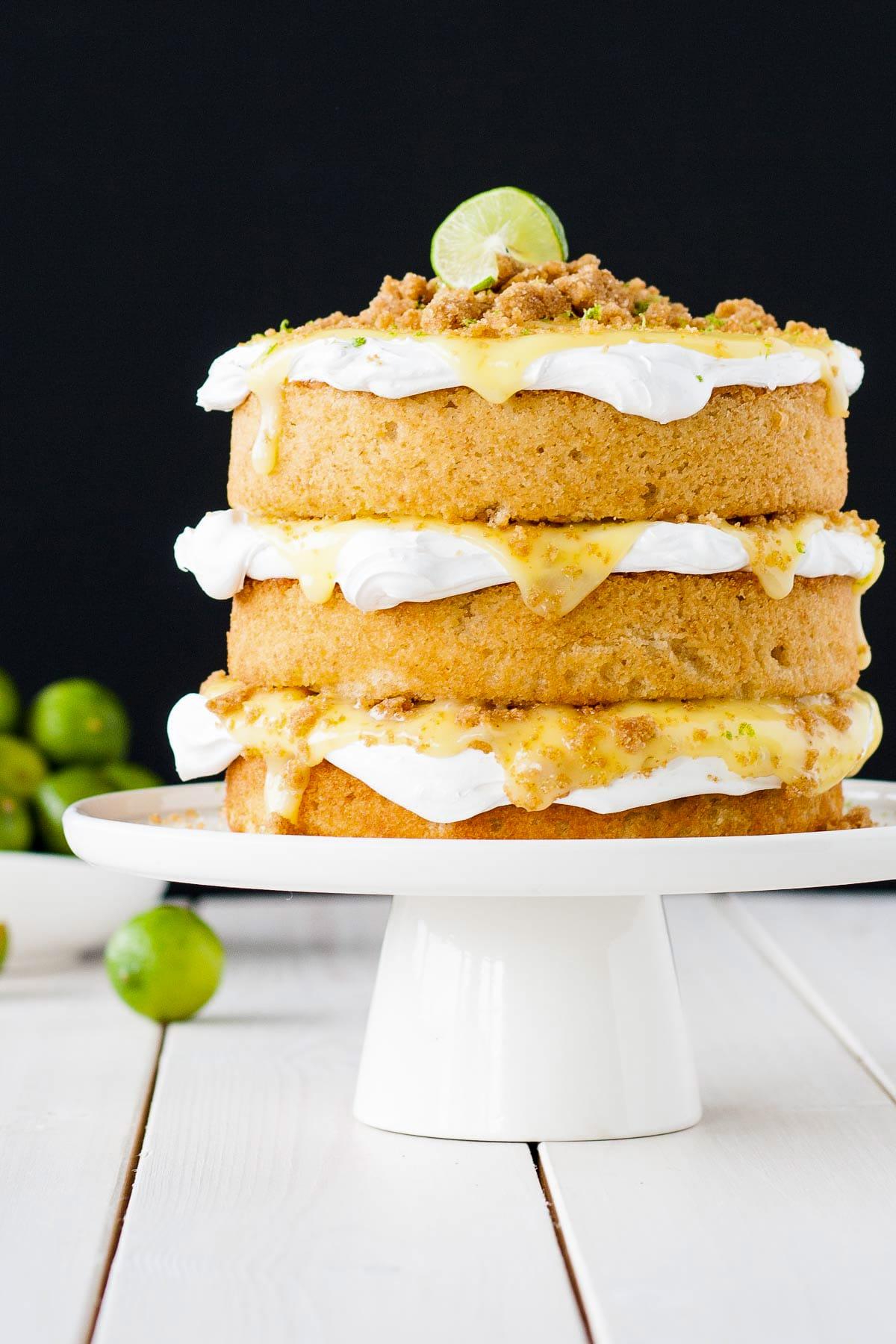 Key Lime Pie Cake! Graham cracker cake topped with meringue, key lime curd, and graham cracker crumble. | livforcake.com