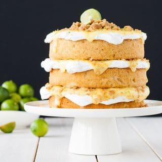 Key Lime Pie Cake! Graham cracker cake topped with meringue, key lime curd, and graham cracker crumble.   livforcake.com