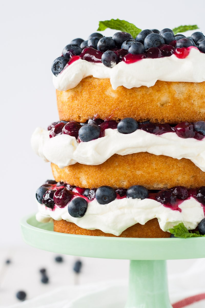 This Blueberry Shortcake is perfectly light dessert for summer. Layers of vanilla cake, whipped cream, blueberry sauce, and fresh blueberries. | livforcake.com