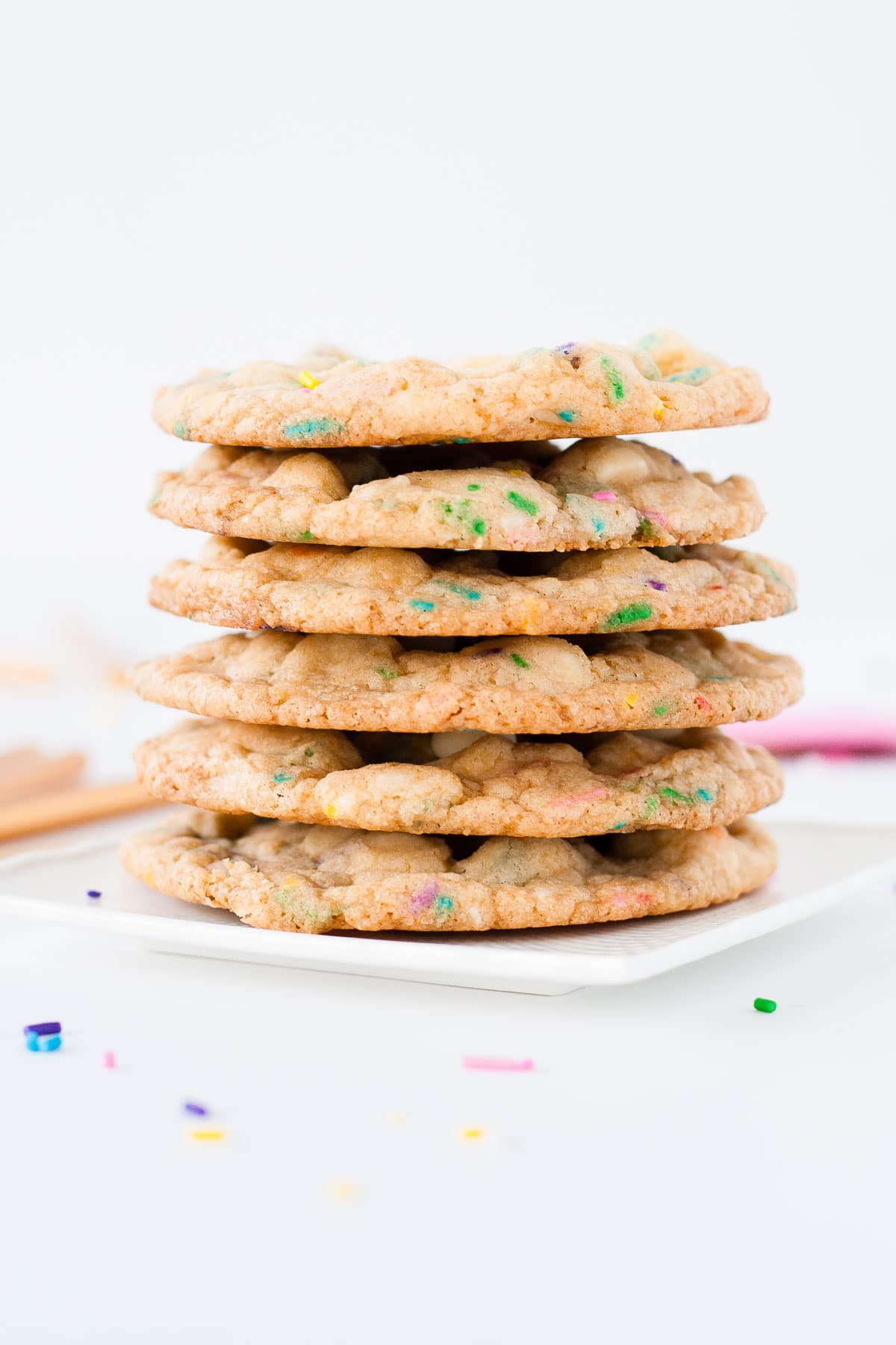 Stack of cookies on a white plate.