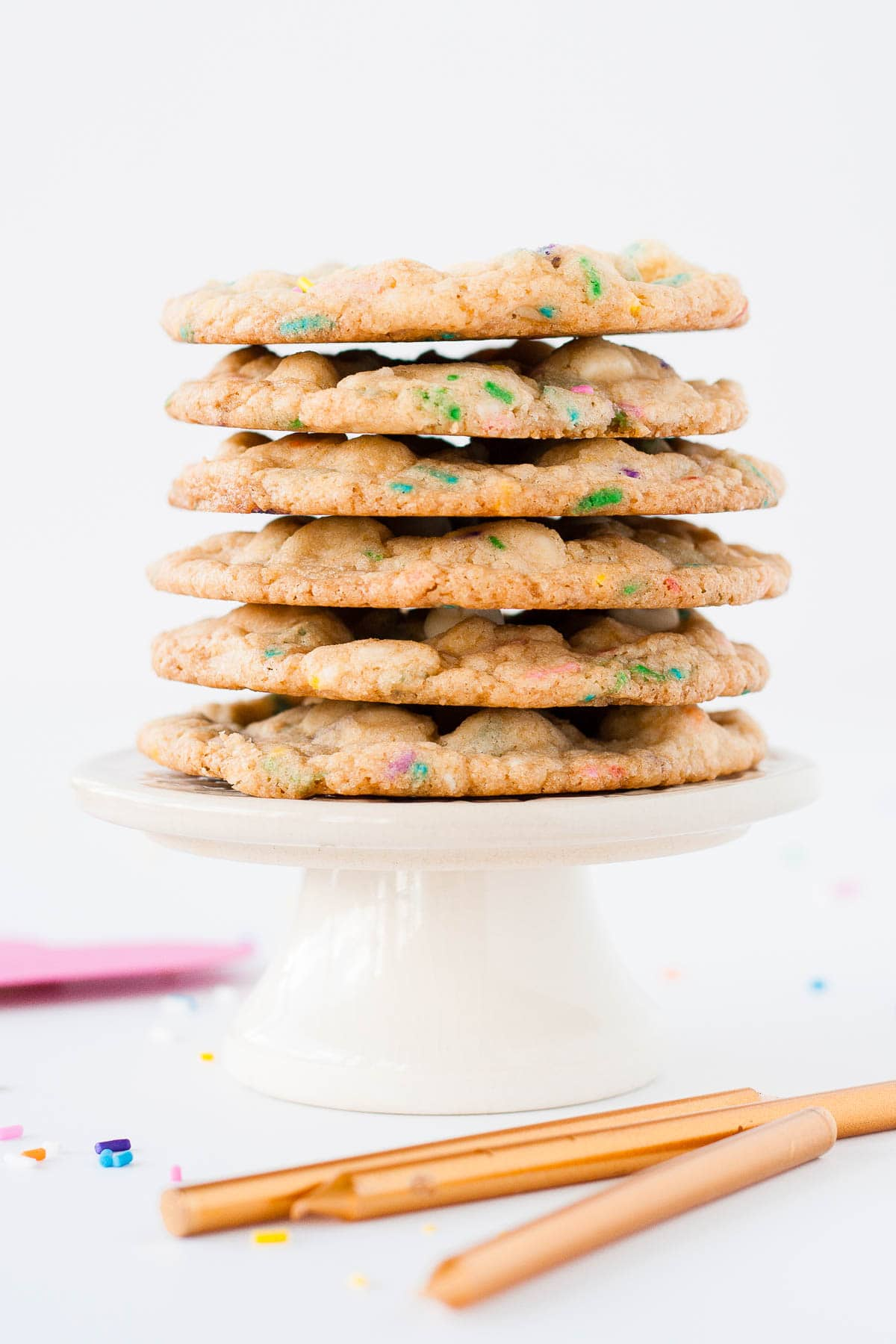 Stack of cookies on a small cupcake stand.