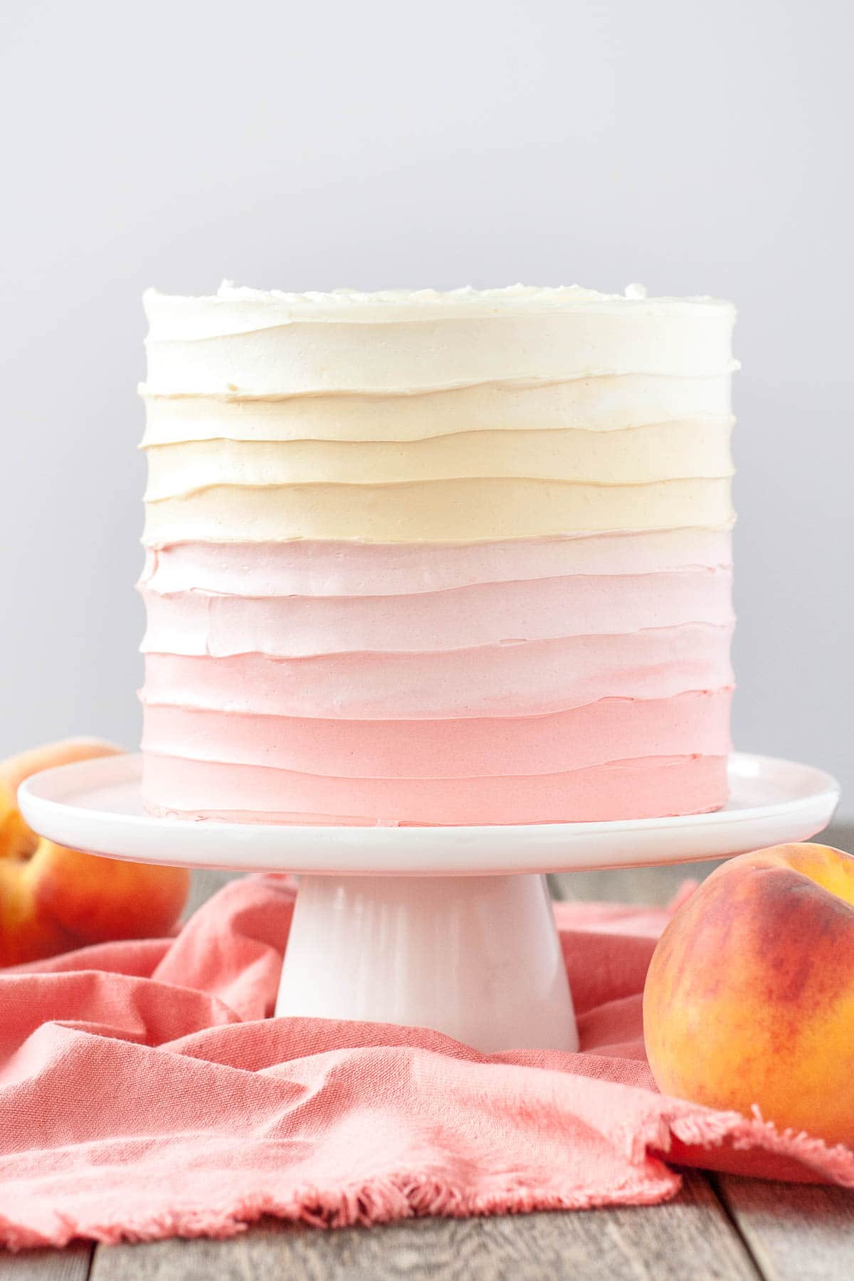 Peach cake with homemade peach filling and ombre peach frosting.