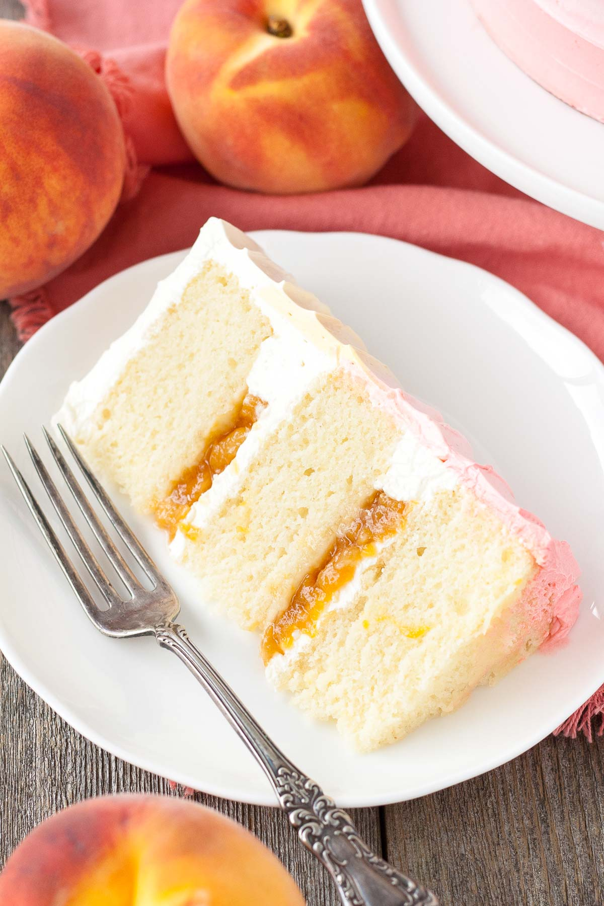 Slice of peach cake on a plate.