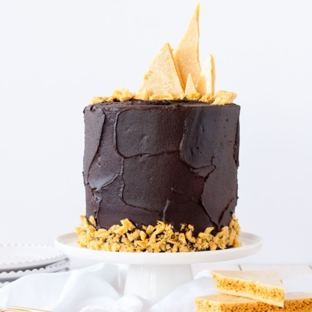 Chocolate cake with honeycomb shards on the top.