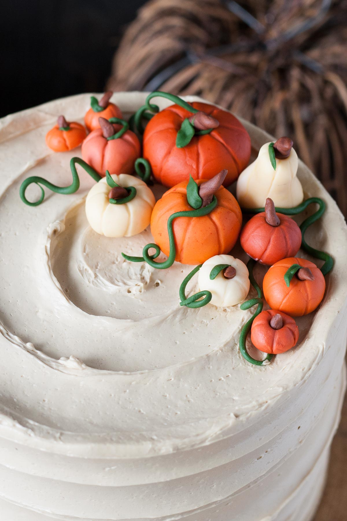 Close up of fondant pumpkins on a pumpkin spice latte cake