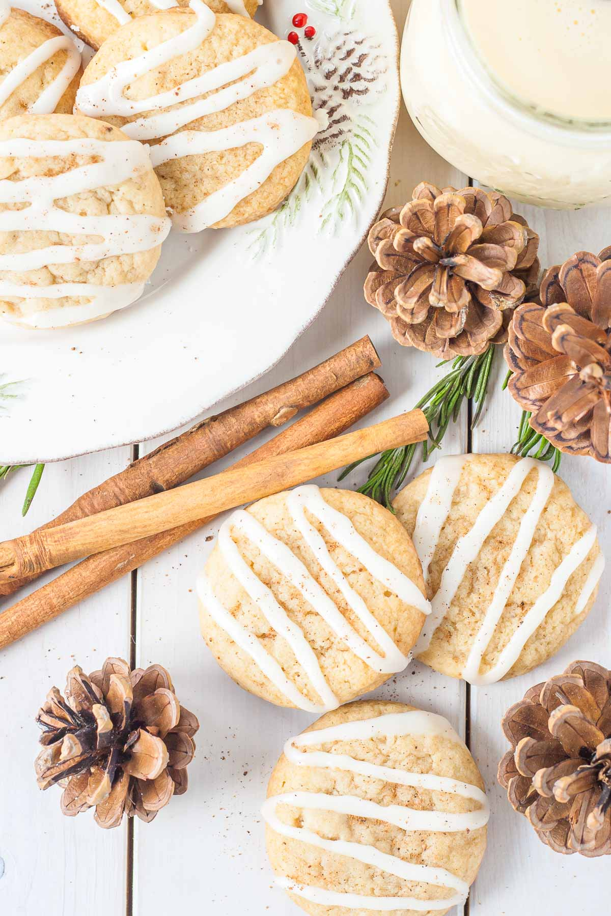 Cookies on a white table with festive decor.