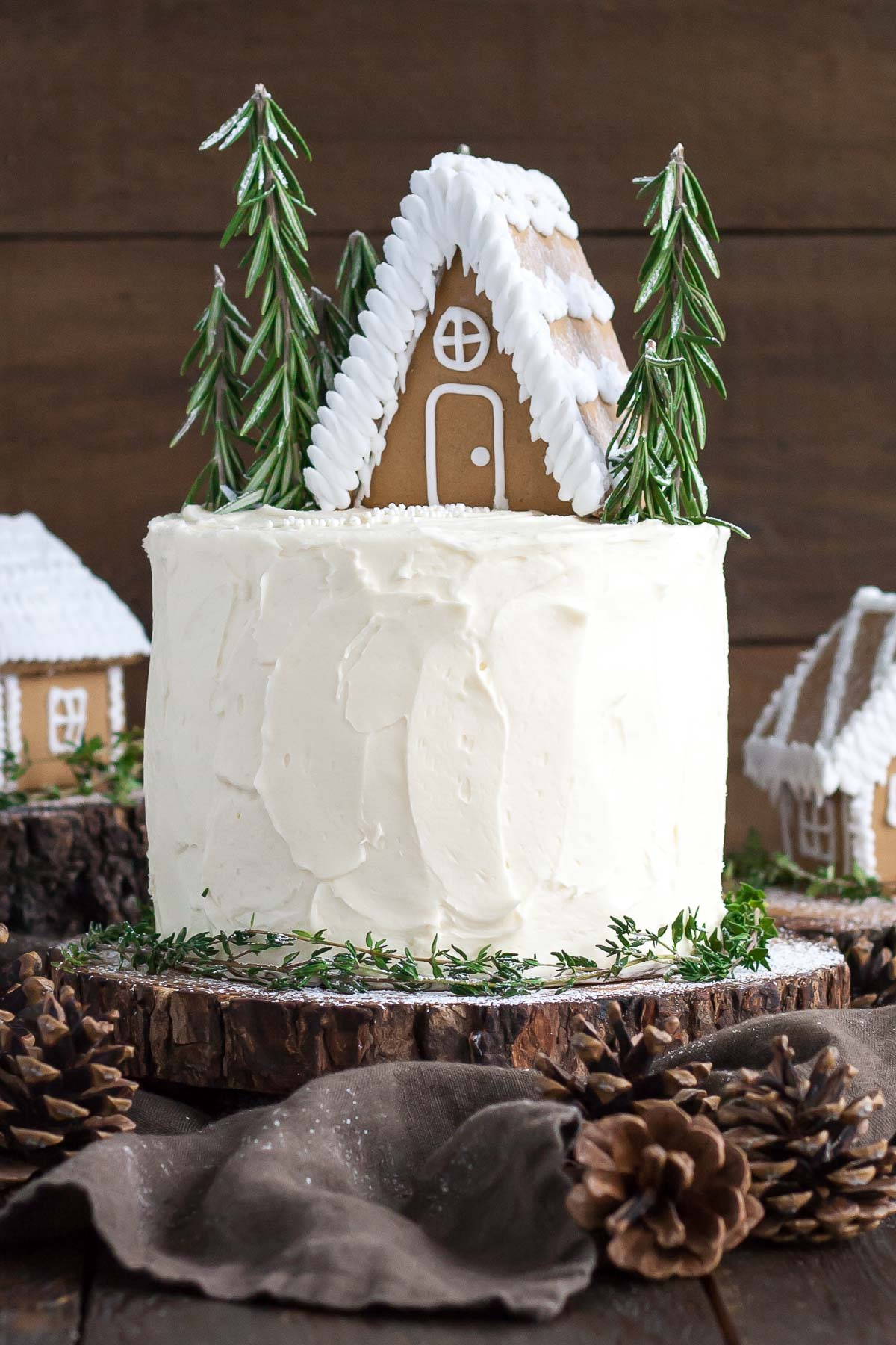 Cake with a gingerbread house on top.